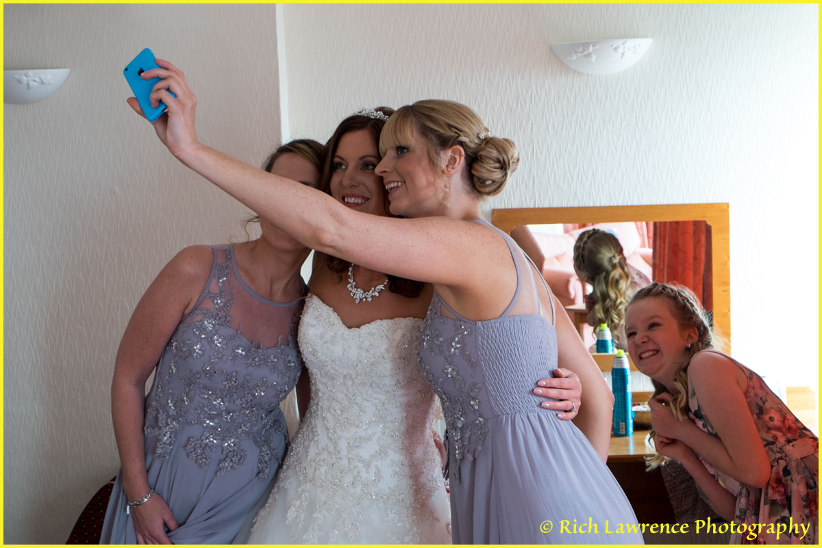 Bride and maids taking selfy