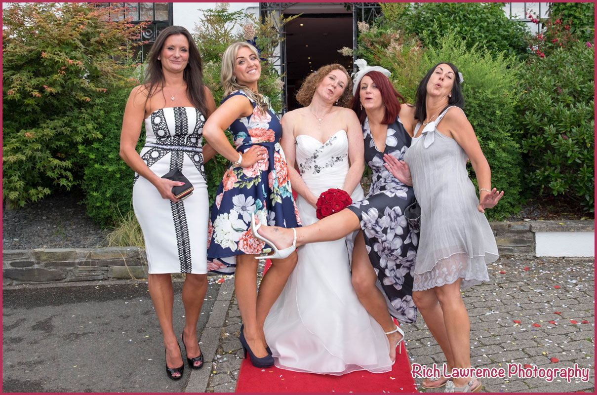 Bride posing with girl friends