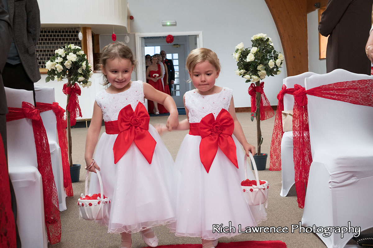 Flower girls walk down the aisle