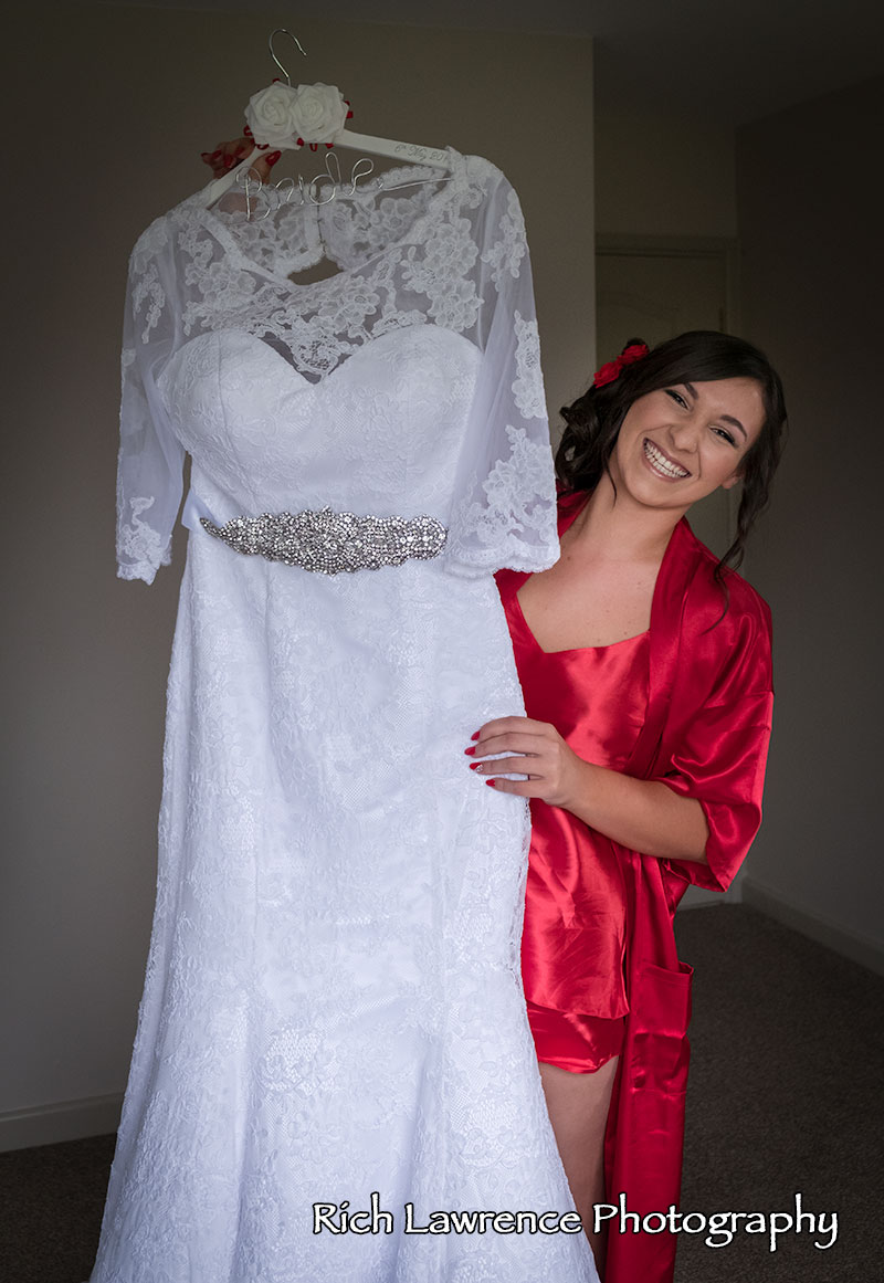 Bride holding wedding dress